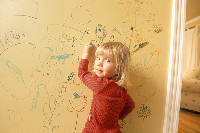 Why do kids like to paint on wallpaper